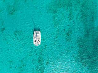 Drone Top View turquoise sea Bahamas Sailing Catamaran Charter
