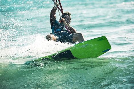 Male-Kite-surfer-Swaying-Palms-Beach-Bun