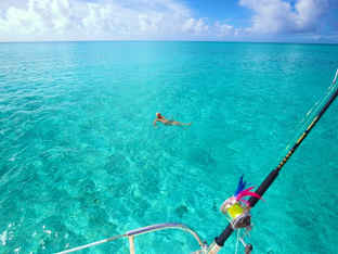 Swimming Clear turquoise ocean Bahamas Sailing Catamaran Charters