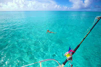 Swimming-clear-ocean-Atwood-Harbour-Beach-Bahamas-Sailing-Catamaran-Charters