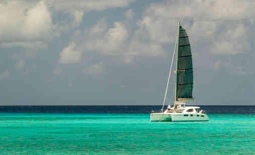 Leopard 46 Black Main Sail Sailing Bahamas Catamaran Charter
