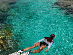 Photo by Stephen Frink Woman Snorkeling.
