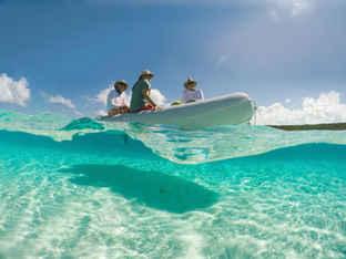 Dinghy Ride crystal clear water Bahamas Sailing Catamaran Charters