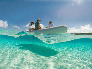 Dinghy Ride crystal clear water Bahamas Sailing Catamaran Charters