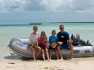 Family in the dinghy - Bahamas