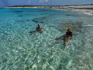 Swimming clear water Bahamas Sailing Catamaran Charters