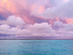 Pink sky and clouds turquoise sea Bahamas Sailing Catamaran Charters