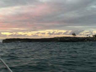 SAiling Catamaran into the SUnset