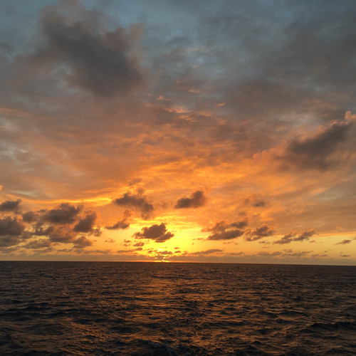 Sunset over sea Bahamas Sailing Charter