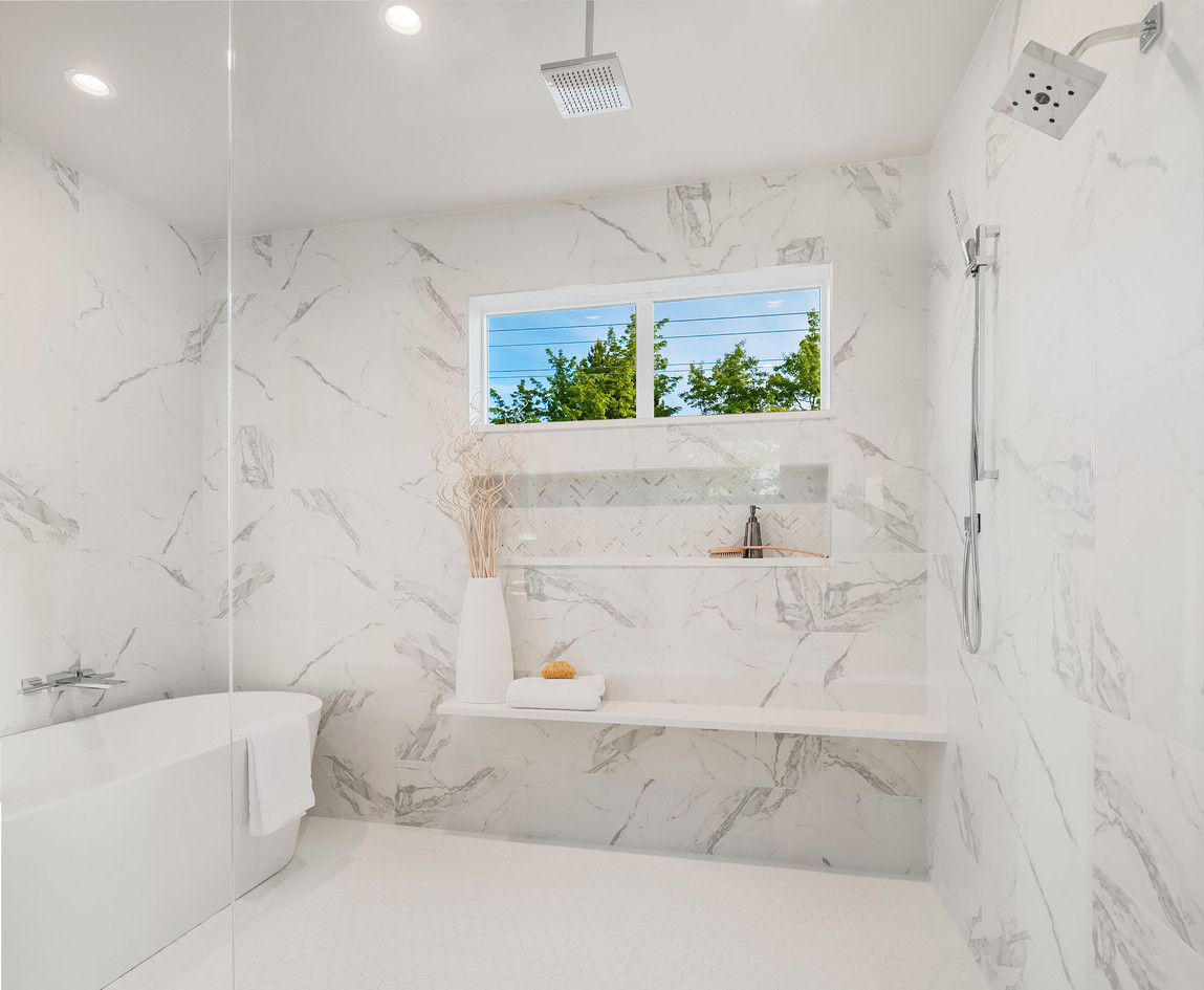 Wet room concept with marble tile by Enf