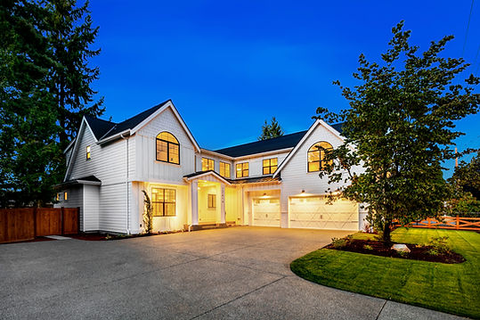 Enfort Homes Kirkland Washington Builder l shaped houseexterior lighting white house farmhouse black windows metal roof 3 car garage