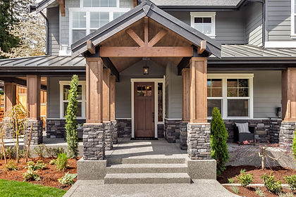 Enfort Homes Kirkland Washington Builder stacked stone wod beams metal roof white trim exposed beams exterior
