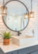 Enfort Homes Kirkland Washington Builder industrial lighting round mirror brick accen wall industrial light switch vessel sink