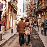 couple-walking-on-street-3450124.jpg