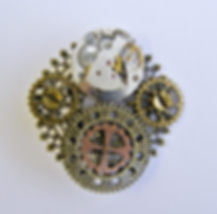 Steampunk brooch watch movement and cogs