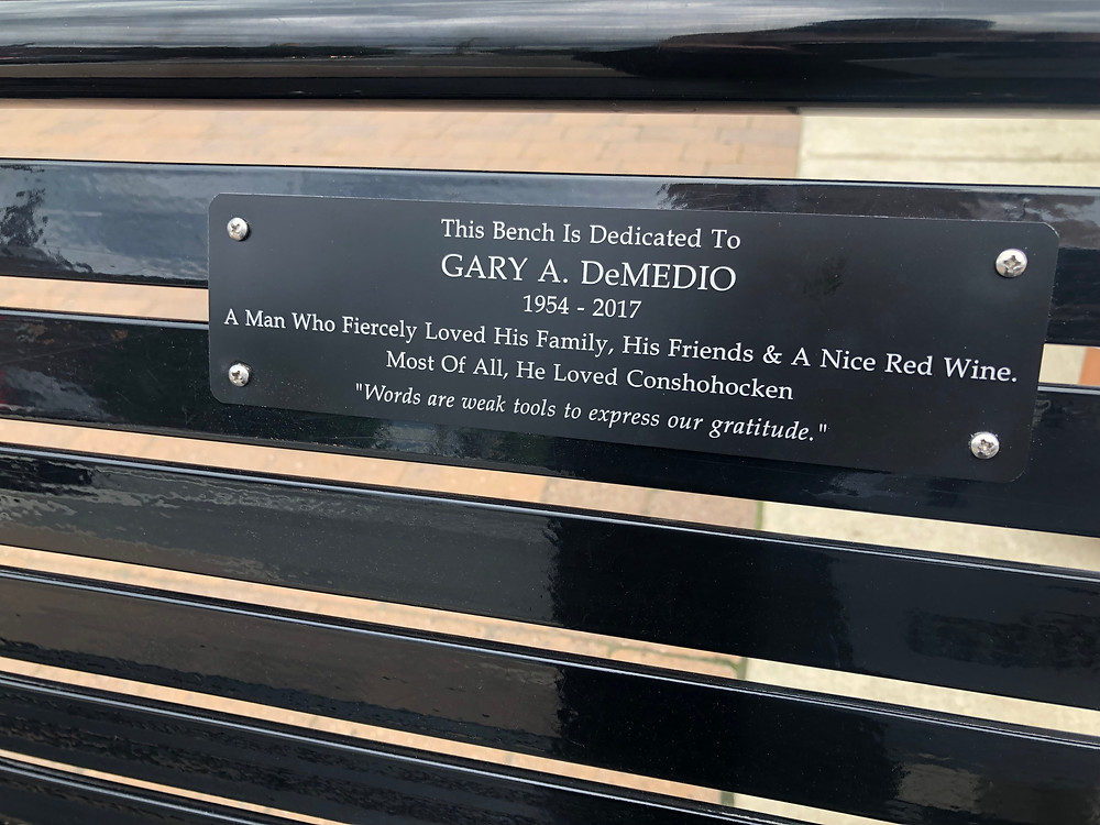 black bench with black plaque