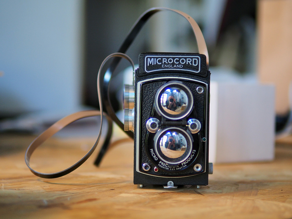 Microcord medium format camera with waist level viewfinder.