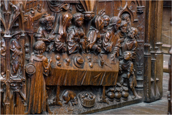 Wedding at Cana, Carved relief on the end of a choir stall. (1508-1519) Cathedrale d'Amines (Notre-Dame Cathedral).