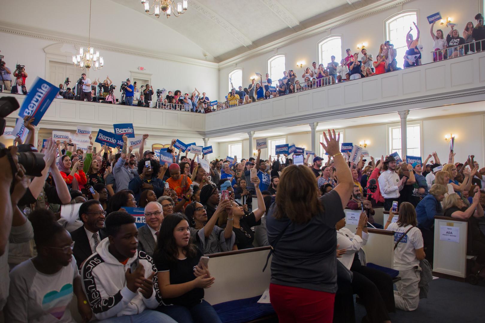 Bernie Sanders supporter cheer on from Bernie Sanders speech.