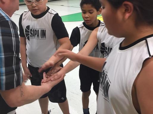 Sapa Un Boys Basketball Team and Cheer squad start the season!