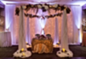 Onsite ceremony arch with sweetheart table