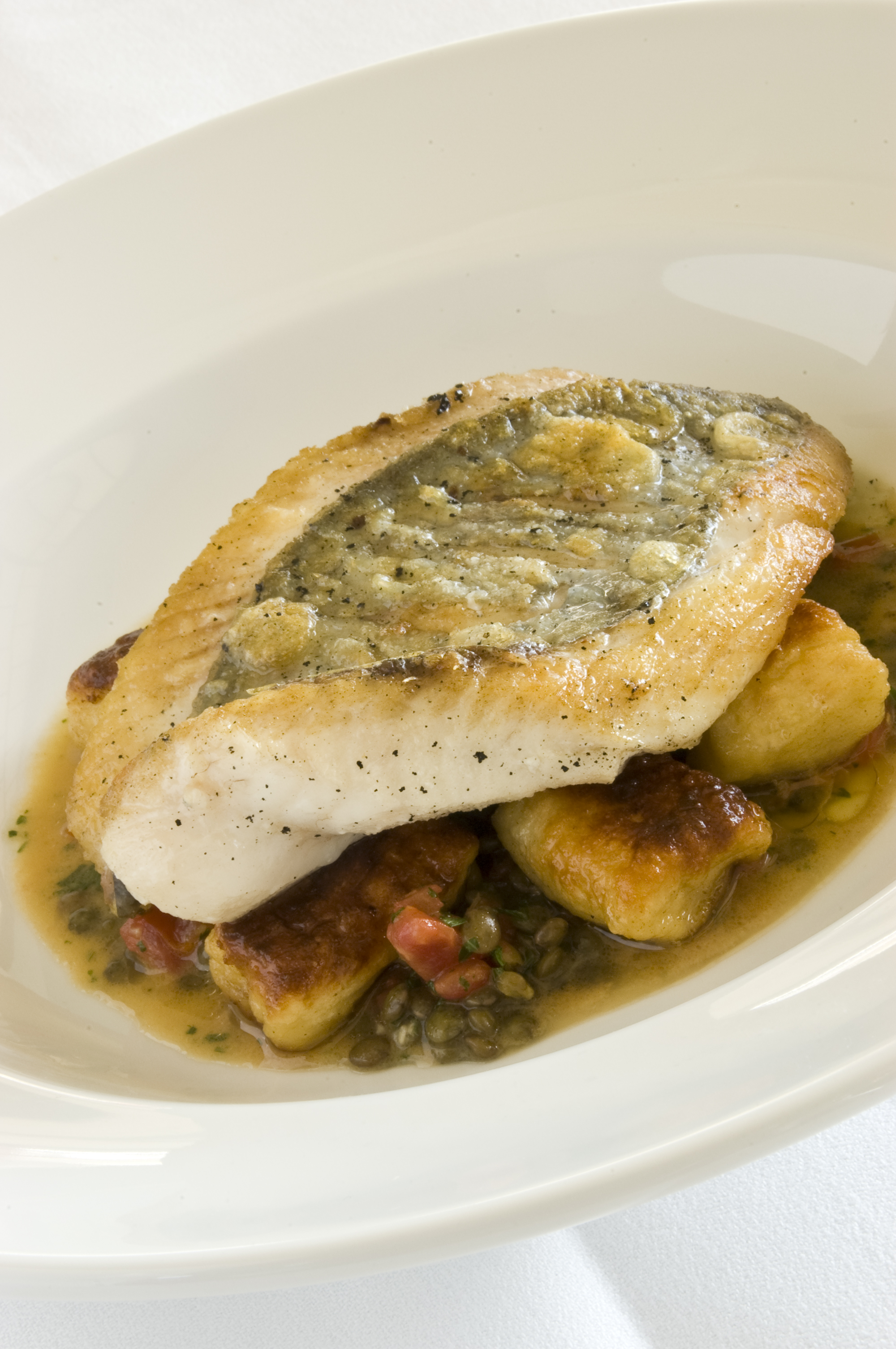 Snapper with gnocchi and lentils