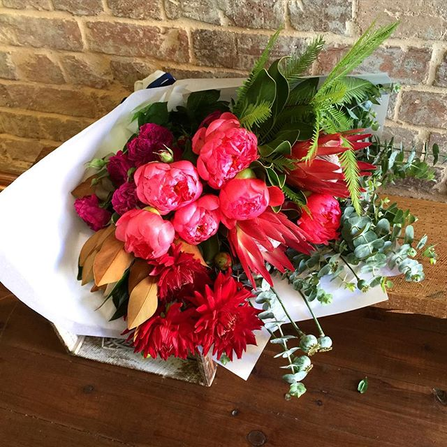 Anniversary bunch for Fem and Courtney - coral peonies, king proteas, David Austins, dahlia and popp