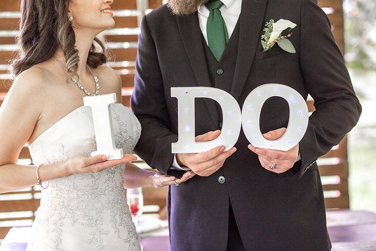 """Couple holding """"I Do"""""""