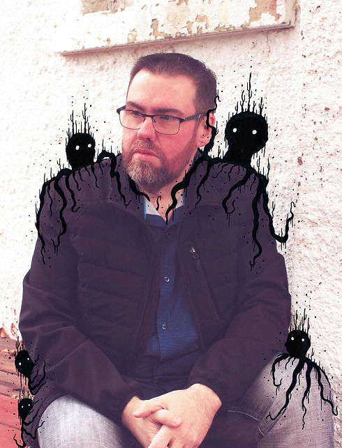 Mark S. Gagne of Mindmelt Studio sitting with cute and creepy creatures