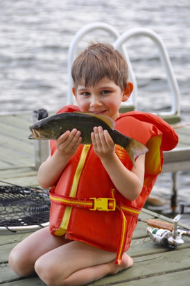 Grayson with his freshly caught bass