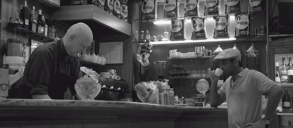 Master of None Black and White Episode Season 2 Episode 1 - Aziz Ansari's Dev drinking coffee in Modena, Italy