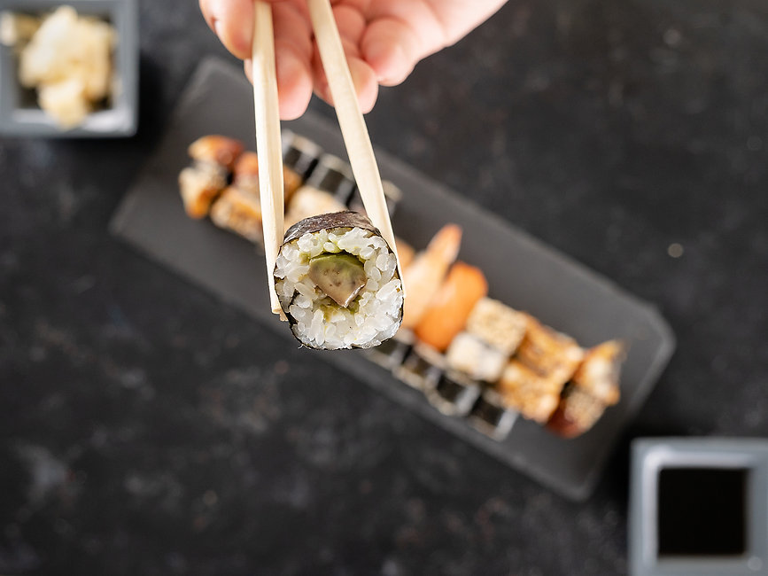 chopstick-with-a-sushi-in-focus-and-a-mix-of-sushi-ZLJ6BUG.jpg