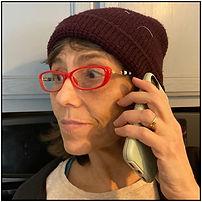 Gwen on cell phone.jpg
