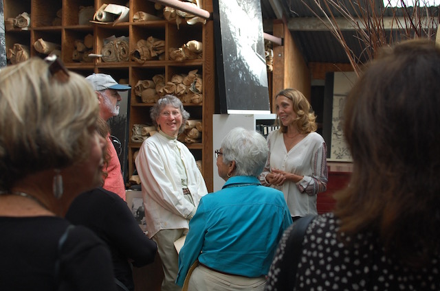Margo Warnecke Merck giving a tour of the Warnecke architectural archive.