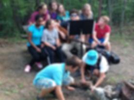 youth_singing_around_campfire.JPG