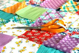 Scissors on patchwork quilt