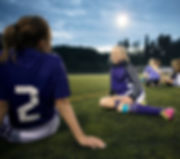 Girls Relaxing on Soccer Field_edited.jpg