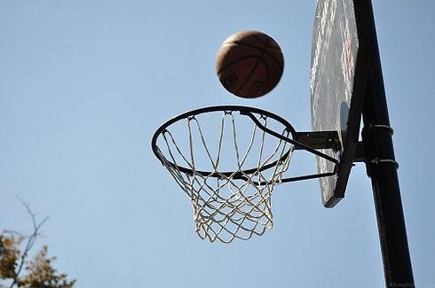 Closeup up basketball going into hoop