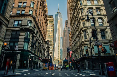 NYC Freedom tower seen between two city blocks
