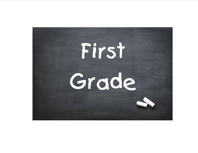 """""""First Grade"""" written on blackboard with chalk"""