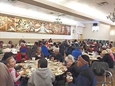 Senior Lunch Program participants enjoying a meal together in the Filipino Community Cente
