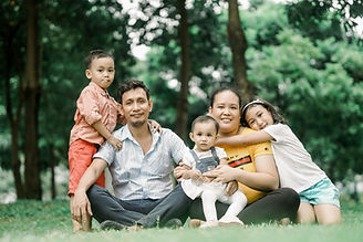 Filipino family taking a photo in the pa