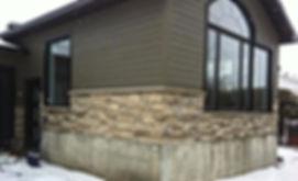Revêtement/rénovation de maçonnerie en pierres décoratives collées extérieur.