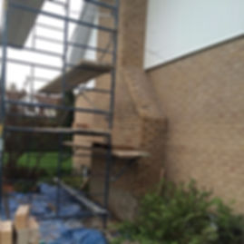 Restauration/rénovation de cheminée en maçonnerie. Briques et pierres