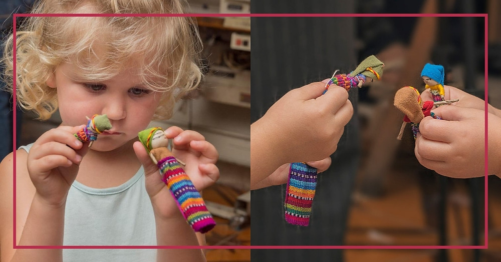 4 year old kid playing with a mayan worry doll