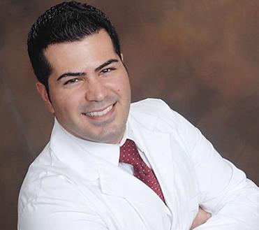 Dr. Sani in white coat