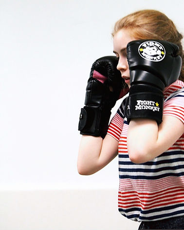 women with boxing gloves on in self defense class