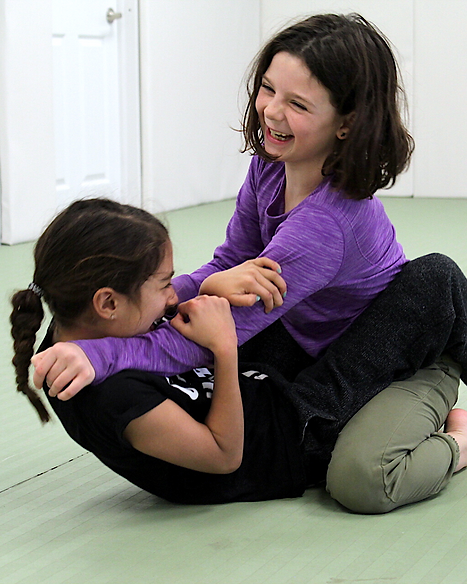 girls practicing self defense at girls who fight