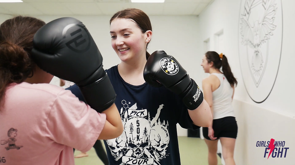 teen girls practicing self defense at girls who fight