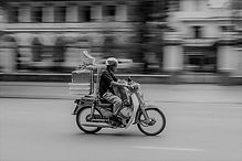 Man on motor cycle delivery.jpeg